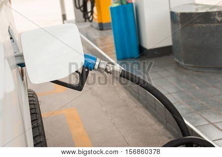 filling Oil Gas Fuel at station, gasoline filling car
