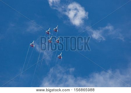 Russian Aerobatic Team Swifts At Air Show. Blue Sky In The Background