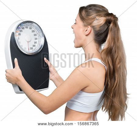 Portrait of a Fit Woman Shouting to a Weight Scale