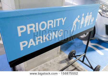 Sign priority parking at shopping mall center