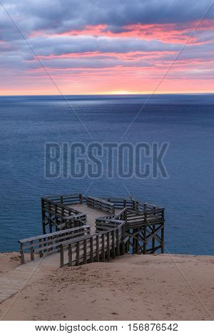 A Lake Michigan sunset glows over Outlook #9 an overlook on Pierce Stocking Drive at Sleeping Bear Dunes