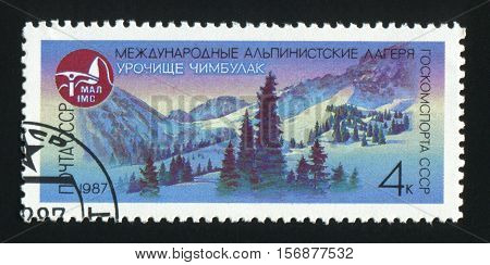 USSR - CIRCA 1987: A post stamp printed in USSR shows image of mountains Chimbulak in USSR circa 1987