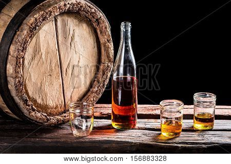 Three Glass Of Aged Whisky And Bottle