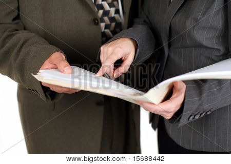 Man and woman looking at business documents