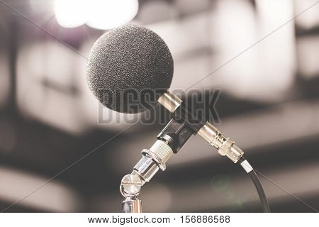 High accuracy microphone in noise (sound) testing room with LED light bokeh. High technology. Microphone for nosie recorder. Selective focus.