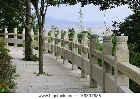 A curved walkway and stone railing on the island of Putuoshan located in Zhejiang Province China.