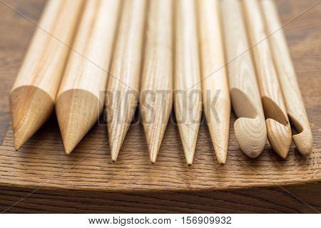 wooden knitting needles on wooden table wooden knitting needles on background of wooden painted floor