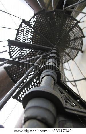 old spiral staircase made of iron. close-up stage