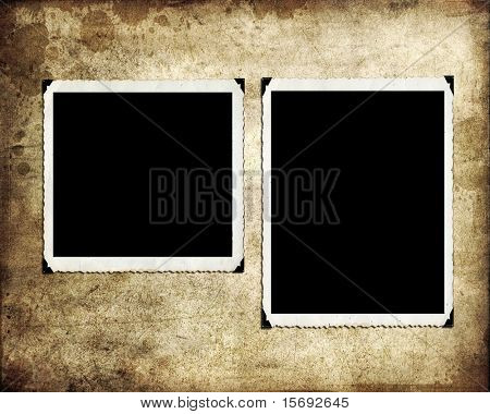 Blank photographs on a grungy paper background