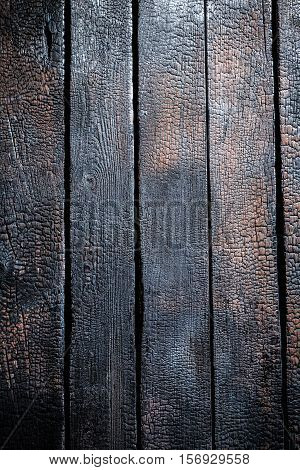 Closeup Of Black Burnt Wooden As Background