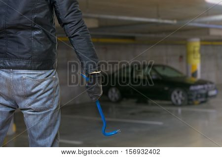 Thief Or Robber Is Going To Steal Parked Car From Parking Lot.