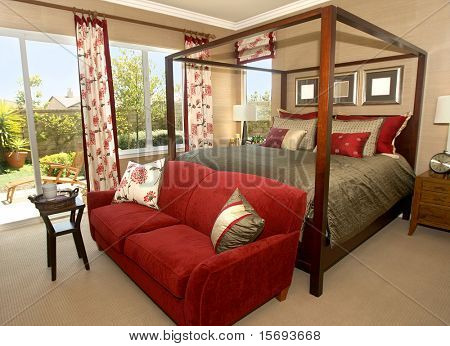 Elegant master bedroom with canopy bed