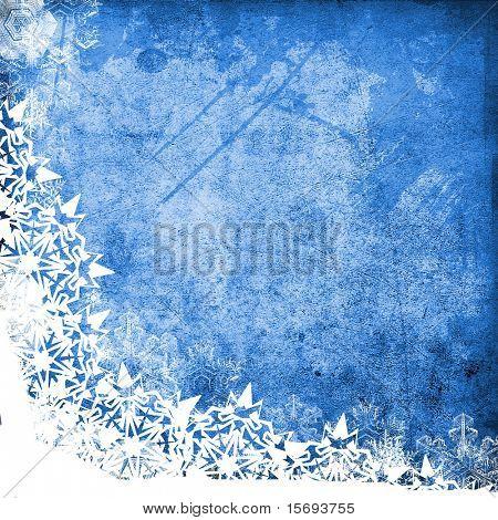 Grunge textura azul con copos de nieve y sala de copia
