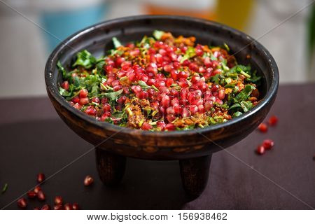 Kuchmachi - traditional Georgian dish of offal with grains of pomegranate
