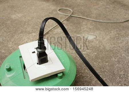 The plug is plugged into the power lines to bring electricity