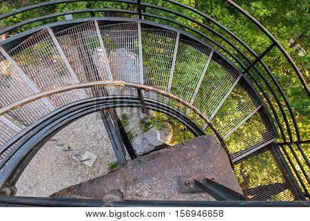 Looking Down on Spiral Metal Staircase with bike rack below