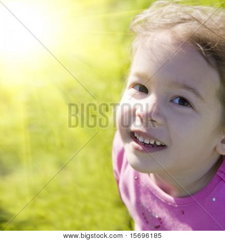 Cute little girl and bright summer sun