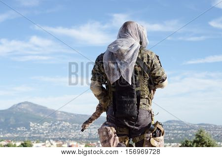 sniper recon target scope multicam ghillie suit, back view