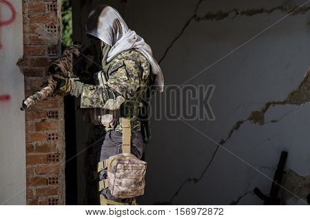 Sniper aim target ghillie suit inside building