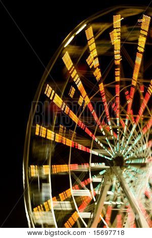 Ferris wheel at night with a motion blur