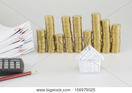 House Have Blur Gold Coins And Paperwork As Background