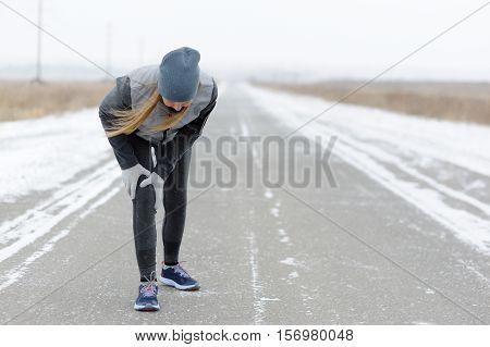 Injuries - Sports Running Knee Injury On Woman. Winter Marathon.