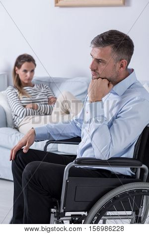 Man On A Wheelchair And His Partner