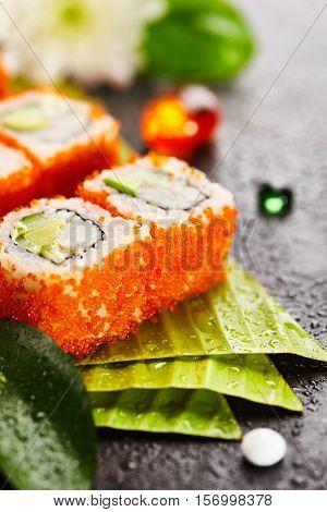 California Maki Sushi with Masago - Roll made of Crab Meat, Avocado, Cucumber, Japanese Mayonnaise inside. Masago (smelt roe) outside