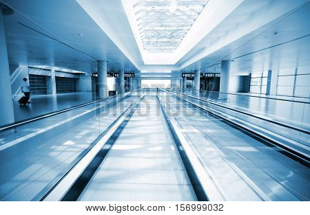 Moving escalator in morden building, Blue tone chart.