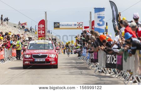 Mont Ventoux France- July 14 2013: The British cyclist Christopher Froome of Team Sky wearing the Yellow Jersey looking back for the followers while climbing the last kilometer of the ascension to Mont Ventoux during the stage 15 of the 100 edition of Le