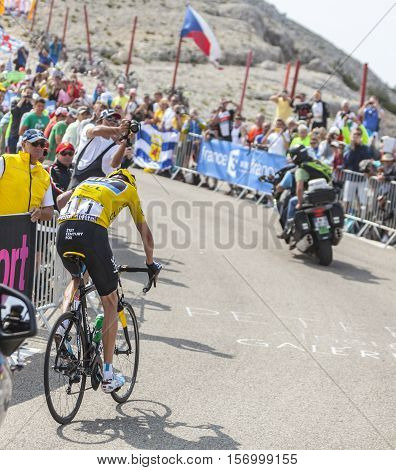 Mont Ventoux France- July 14 2013: The British cyclist Christopher Froome of Team Sky wearing the Yellow Jersey climbing the last kilometer of the ascension to Mont Ventoux during the stage 15 of the 100 edition of Le Tour de France 2013. Froome won this