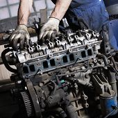picture of internal combustion  - Auto mechanic checking an internal combustion engine - JPG