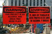 foto of workplace accident  - A sign in both English and Spanish that says  - JPG