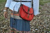 stock photo of sling bag  - a lady carrying a red sling bag - JPG
