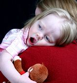 Cute Little Girl Laying Her Head On Mothers Shoulder poster