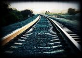 Cross-processed train track with added grunge effect