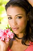 pic of black woman spa  - Beautiful exotic woman with a red hibiscus - JPG