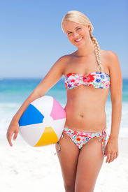 stock photo of beach-ball  - Woman with her ball on the beach - JPG