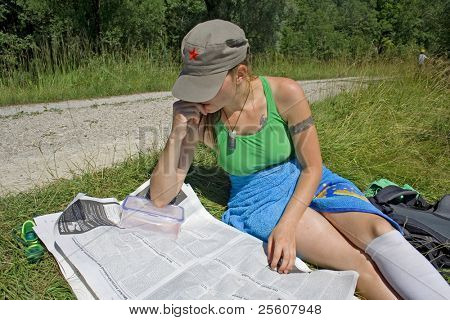 woman reading with cap