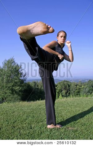 sole kick- attractive young woman practising self defense