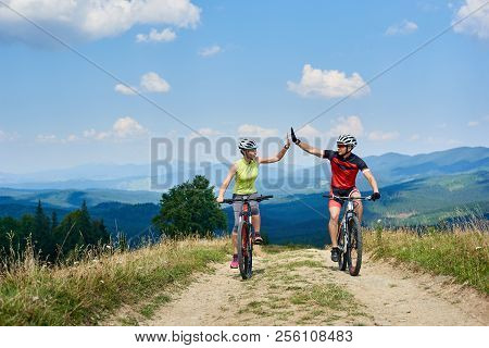 Happy Couple Bicyclists In Professional