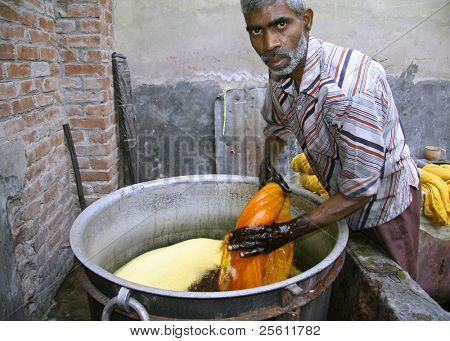 man dyeing textile in india