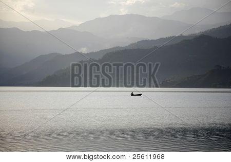 boat on fewa lake at sunset, pokhara, nepal