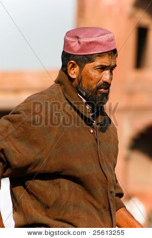 DELHI  - FEBRUARY 11: Bearded middle aged muslim wearing Taqiyah at Jama Masjid on February 11, 2008 in Delhi, India. This mosque is the largest and most frequented in India.