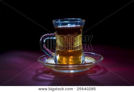 A classic arabic tea cup on dark background