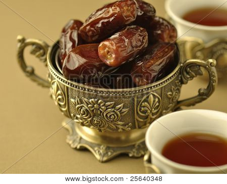 Close up of  dates and black tea