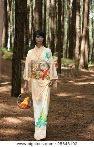 woman with yukata bring fan,