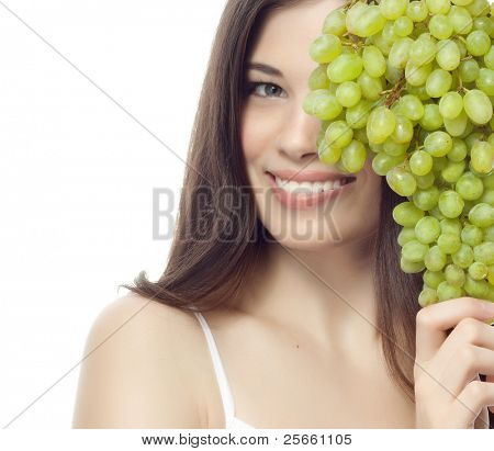 portrait of attractive  caucasian smiling woman isolated on white studio shot with green grapes