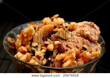 small bowl with ice cream and walnuts