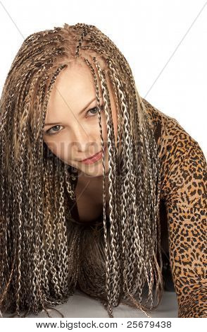 Portrait of the beautiful young woman with dreadlocks on a white background